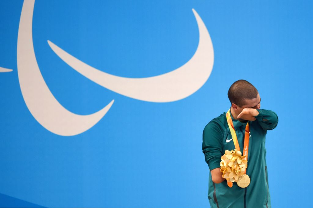RIO DE JANEIRO, Sept. 18, 2016 - Daniel Dias of Brazil reacts during the medal presenting ceremony after Men's 100m Freestyle S5 Final of swimming event at the 2016 Rio Paralympic Games in Rio de ...