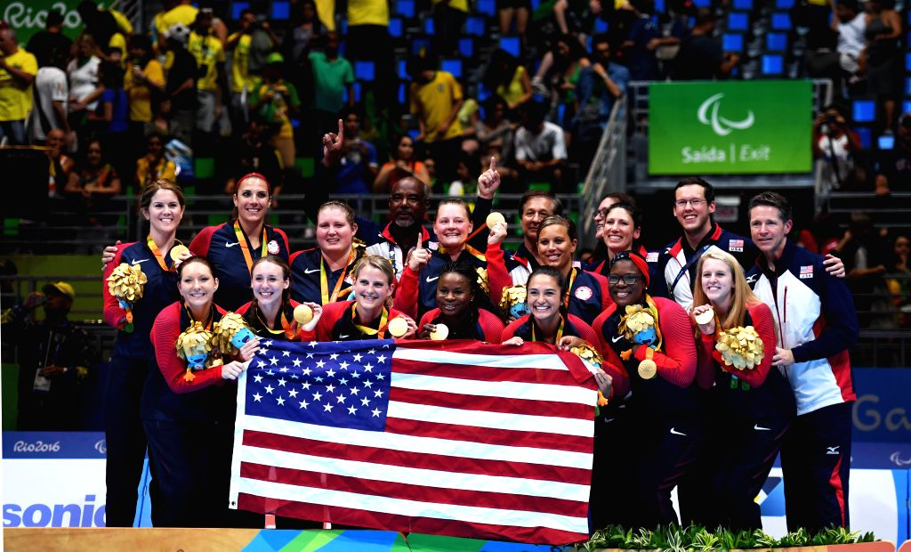 RIO DE JANEIRO, Sept. 18, 2016 - Players of the United States celebrate during the awarding ceremony after the women's gold medal match of the sitting volleyball event against China at the 2016 Rio ...