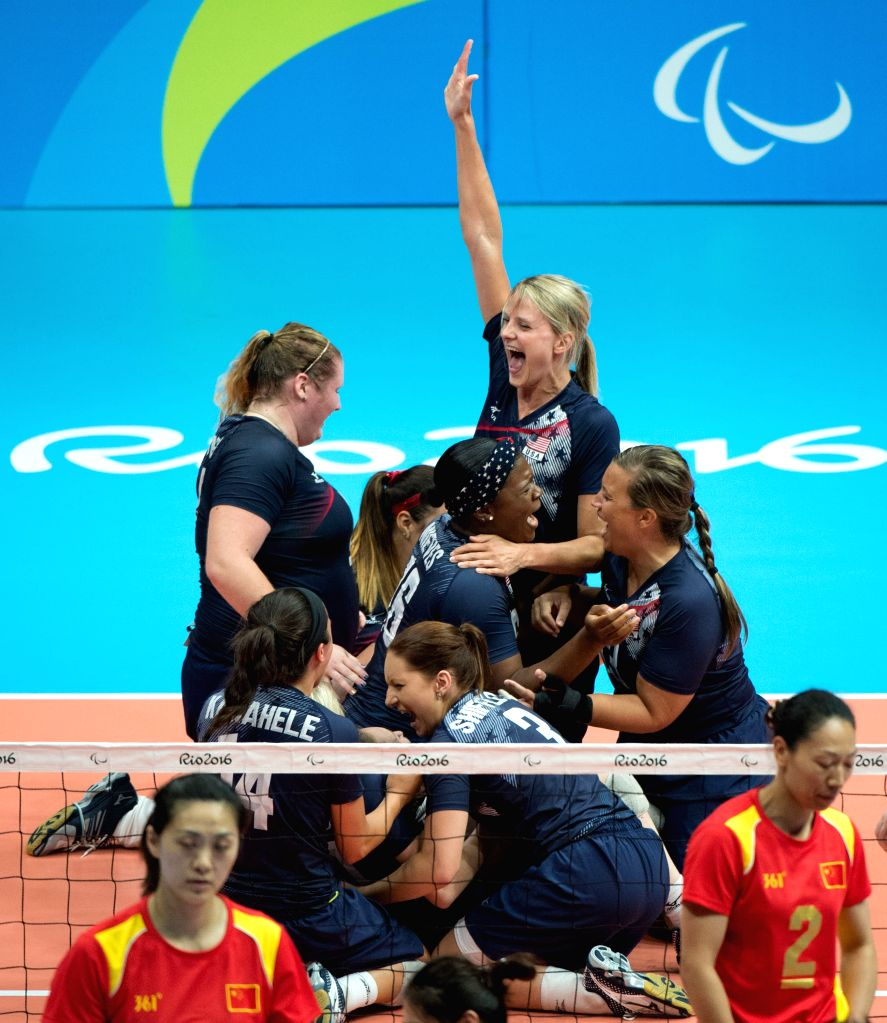 RIO DE JANEIRO, Sept. 18, 2016 - Players of the United States celebrate after the women's gold medal match of the sitting volleyball event against China at the 2016 Rio Paralympic Games in Rio de ...