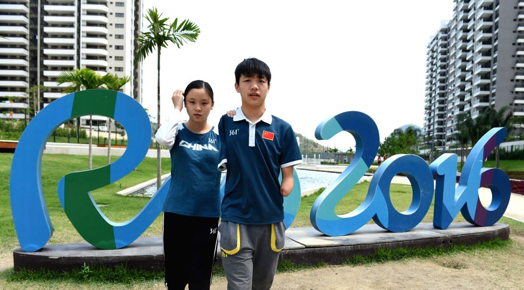 RIO DE JANEIRO, Sept. 18, 2016 - Yang Hong (R) and Cai Liwen pose for photos at the Paralympic Village in Rio de Janeiro, Brazil, on Sept. 14, 2016. Sixteen-year-old Yang Hong and eighteen-year-old ...