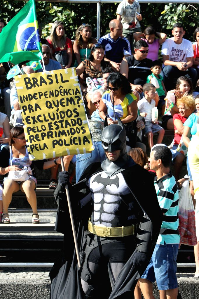 Demonstrators participate in a protest during a parade to commemorate Brazil's Independence Day, at the Presidente Vargas Avenue, in Rio de Janeiro, Brazil, .