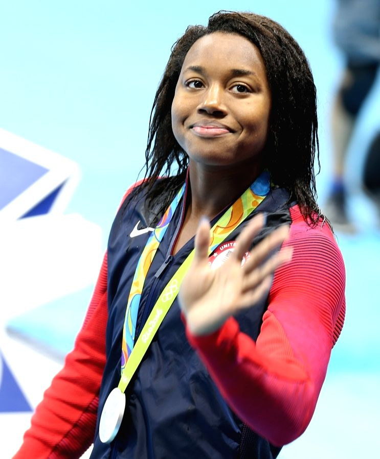 Rio De Janeiro: Simone Manuel of US who won silver medal in Women's 50m Freestyle at Rio 2016 Olympics during the presentation ceremony in Rio de Janeiro, Brazil on Aug 14, 2016.