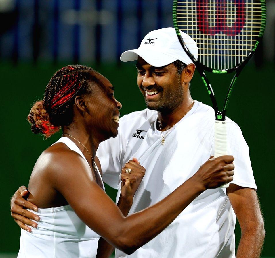 Rio de Janeiro: Venus Williams and Rajeev Ram of US celebrates win against Indian tennis player Sania Mirza and Rohan Bopanna in the semi-finals of the mixed doubles tennis in Rio de Janeiro on Aug. ... - Sania Mirza and Rohan Bopanna