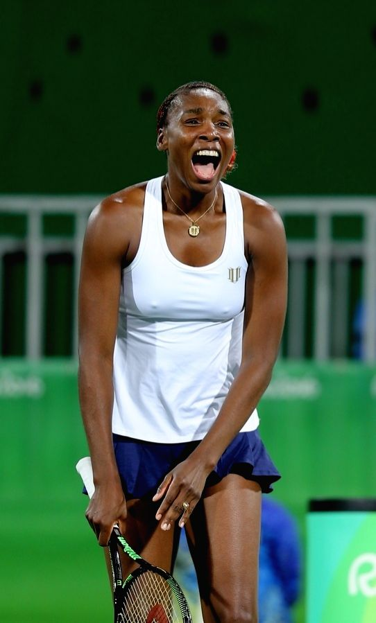Rio de Janeiro: Venus Williams of US celebrates win against Indian tennis player Sania Mirza and Rohan Bopanna in the semi-finals of the mixed doubles tennis in Rio de Janeiro on Aug. 13, 2016. - Sania Mirza and Rohan Bopanna