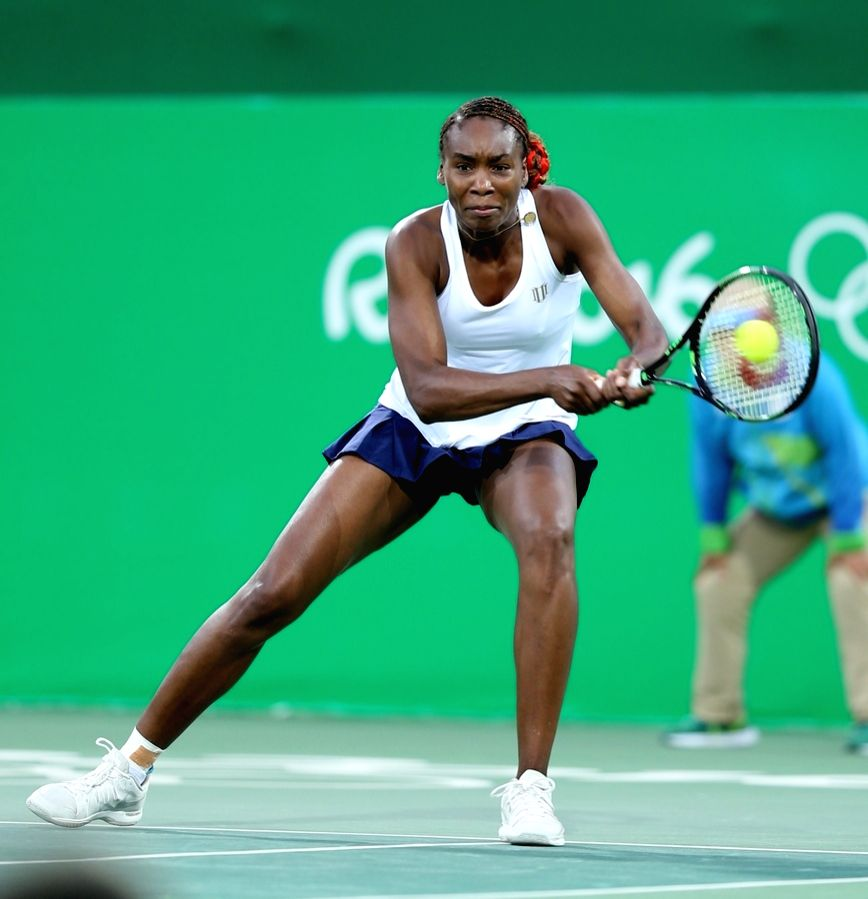 Rio de Janeiro: Venus Williams of US in action against Indian tennis player Sania Mirza and Rohan Bopanna in the semi-finals of the mixed doubles tennis in Rio de Janeiro on Aug. 13, 2016. - Sania Mirza and Rohan Bopanna