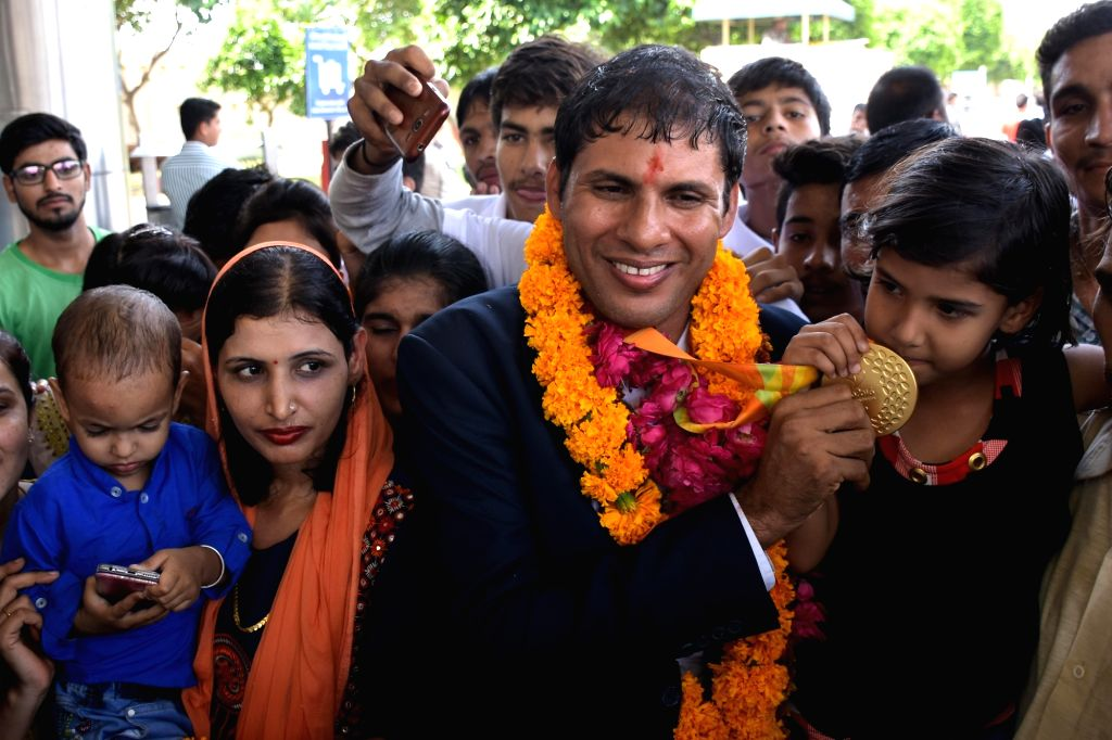 Rio gold medallist Paralympian Devendra Jhajharia (Javelin Throw) arrives at Jaipur International Airport in Jaipur on Sept 24, 2016.