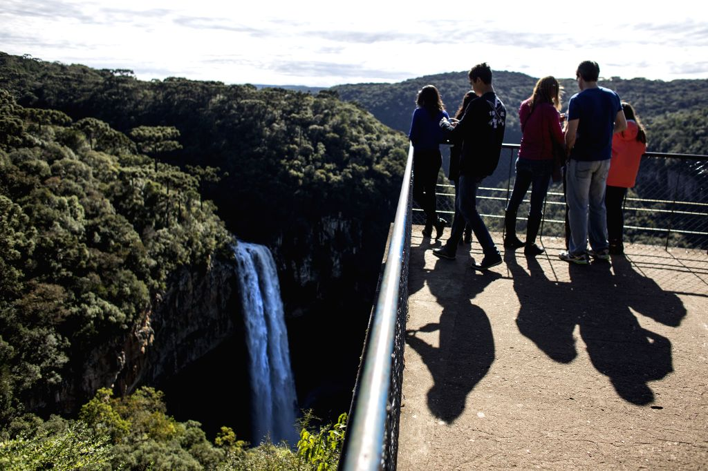Tourists visit the Caracol Falls in the Municipality of Canela, Rio Grande do Sul state, Brazil, on July 2, 2014. Located in the Serra Gaucha region, the ..