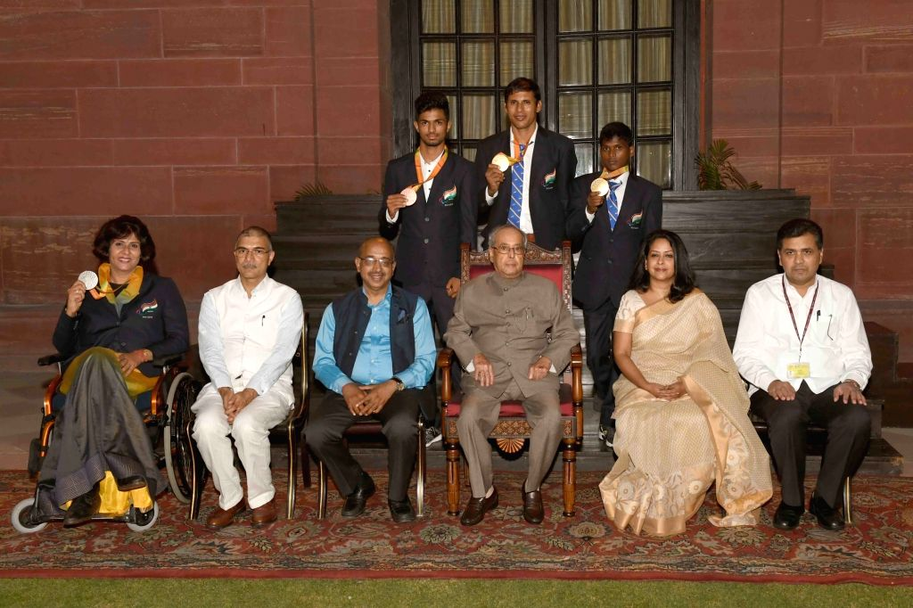 Rio Paralympian medallists meets President Pranab Mukherjee at Rashtrapati Bhavan in New Delhi on Sept 30, 2016. Also seen Union Minister of State for Youth Affairs and Sports (I/C), Water ... - Pranab Mukherjee