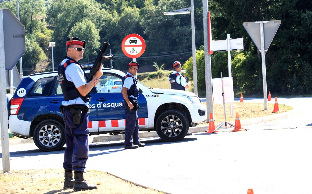 RIPOLL, Aug. 23, 2017 (Xinhua) -- Police officers stand guard in Ripoll, north of Barcelona, Spain, Aug. 21, 2017. Most of the terror suspects responsible for last week's attacks in Barcelona and Cambrils came from the town of Ripoll, according to th