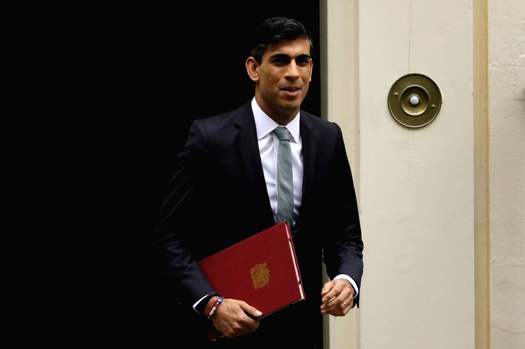 Rishi Sunak, Britain's Chancellor of the Exchequer, leaves 10 Downing Street for the House of Commons in London, Britain, on July 8, 2020. The British government on ...