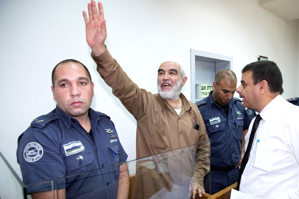 RISHON LEZION (ISRAEL), Aug. 15, 2017 Sheik Raed Salah (2nd L) arrives at Rishon Lezion Justice court in Rishon Lezion, near Tel Aviv, Israel, on Aug. 15, 2017. Israeli police said in a ...