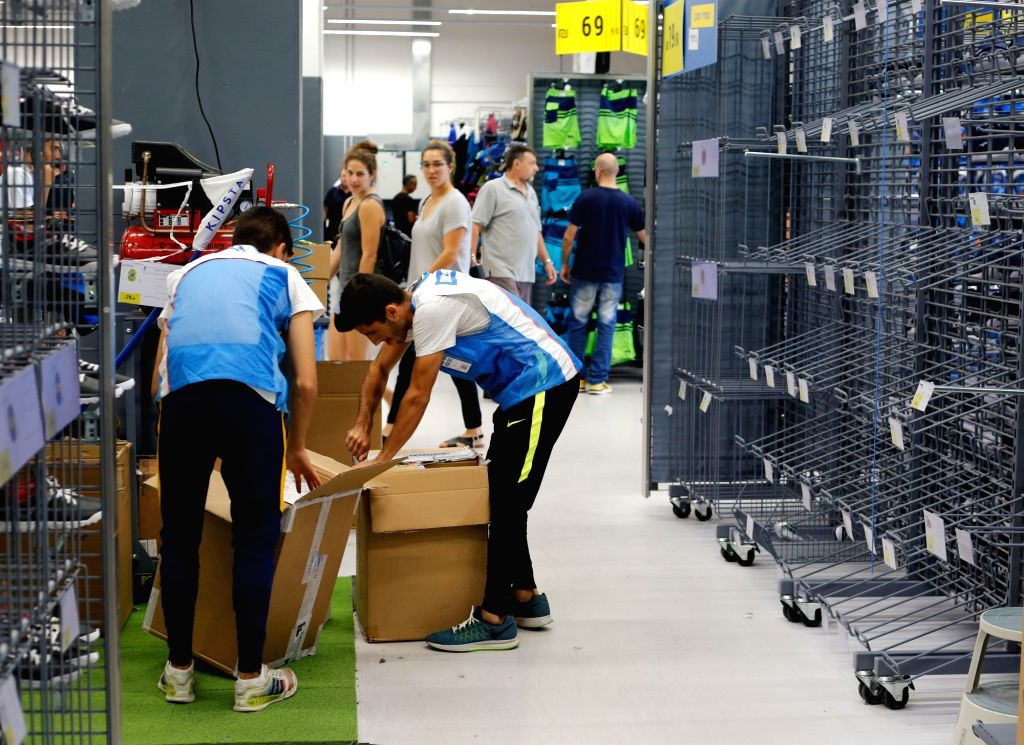 RISHON LEZION, Sept. 12, 2017 - Customers pass by empty shelves at Decathlon Sportswear Store in Rishon Letzion near Tel Aviv, Israel, on Sept. 11, 2017. French sports chain store Decathlon opened ...