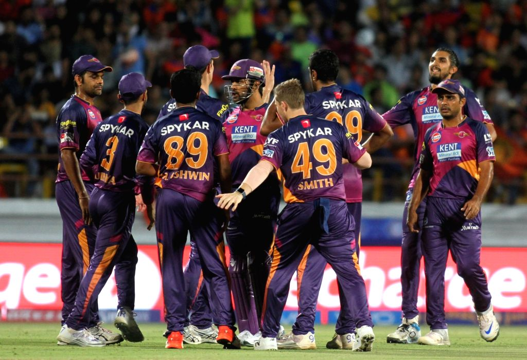 Rising Pune Supergiants celebrate fall of a wicket during an IPL match between Rising Pune Supergiants and Gujarat Lions at Saurashtra Cricket Association Stadium in Rajkot on April 14, 2016.