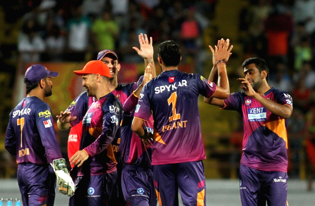 Rising Pune Supergiants celebrates fall of a wicket during an IPL match between Rising Pune Supergiants and Gujarat Lions at Saurashtra Cricket Association Stadium in Rajkot on April 14, 2016.