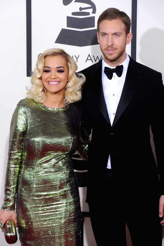 :Rita Ora (L) and her boyfriend Calvin Harris arrive on the red carpet for the 56th Grammy Awards at the Staples Center in Los Angeles, the United States, on ...