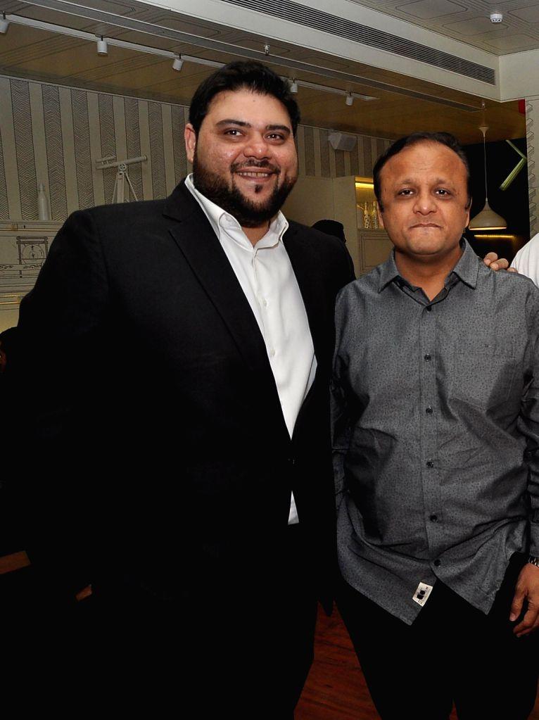 Riyaaz Amlani and Asif Bhamla during the launch of Smoke House Deli BKC branch in Mumbai on Friday, December 20th, 2013.