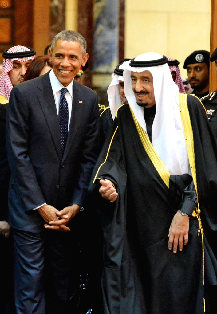 U.S. President Barack Obama talks with Saudi Arabia's King Salman bin Abdulaziz Al Saud(R) after arriving in Riyadh, Saudi Arabia, on Jan. 27, 2015. Obama cut short .