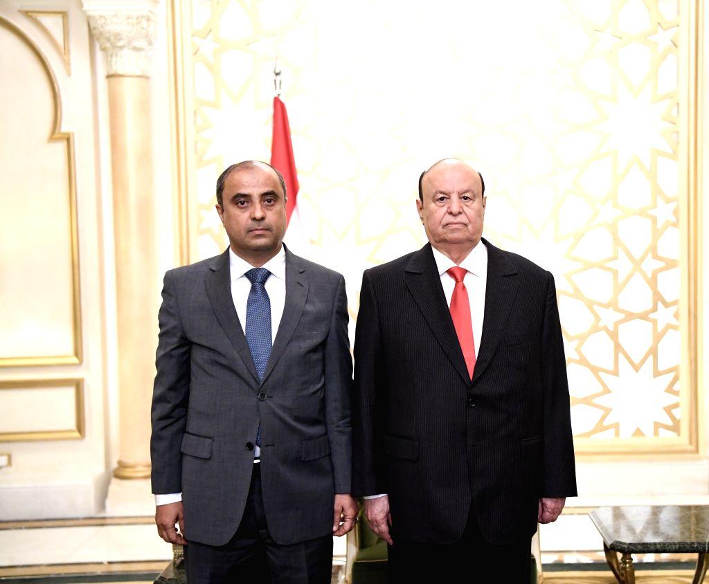 RIYADH, Sept. 21, 2019 - Yemen's newly-appointed minister of finance Salem bin Breik (L) and Yemen's President Abdu-Rabbu Mansour Hadi pose for photos in Riyadh, Saudi Arabia, on Sept. 21, 2019. ...