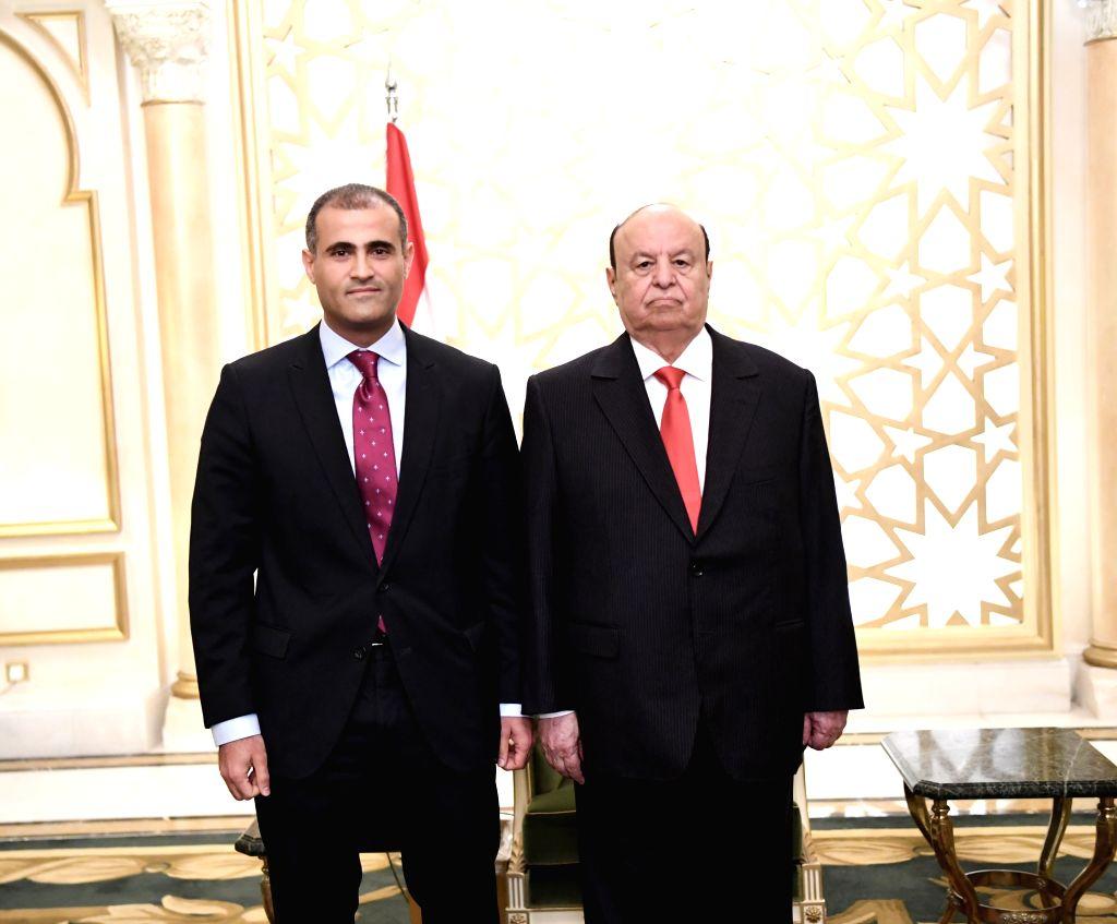 RIYADH, Sept. 21, 2019 - Yemen's newly-appointed minister of foreign affairs Mohammed al-Hadhrami (L) and Yemen's President Abdu-Rabbu Mansour Hadi pose for photos in Riyadh, Saudi Arabia, on Sept. ...