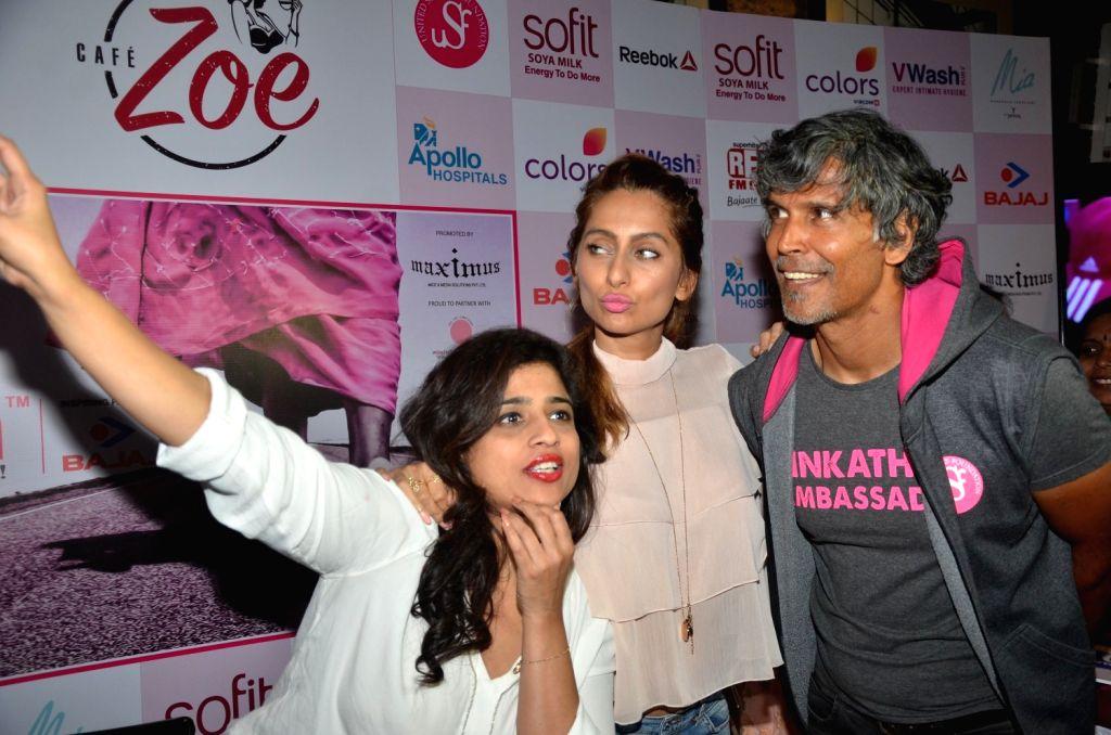 RJ Malishka, actress Anusha Dandekar and model Milind Soman during the announcement of Fifth Edition of Pinkathon, India`s biggest women`s run in Mumbai on Nov 22, 2016. - Anusha Dandekar