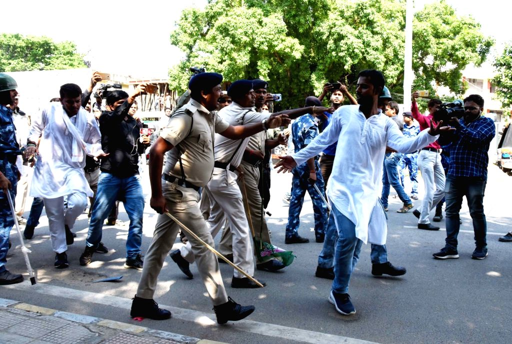RJD activists clash with security personnel during a demonstration to press for their various demands in Patna on July 27, 2019.