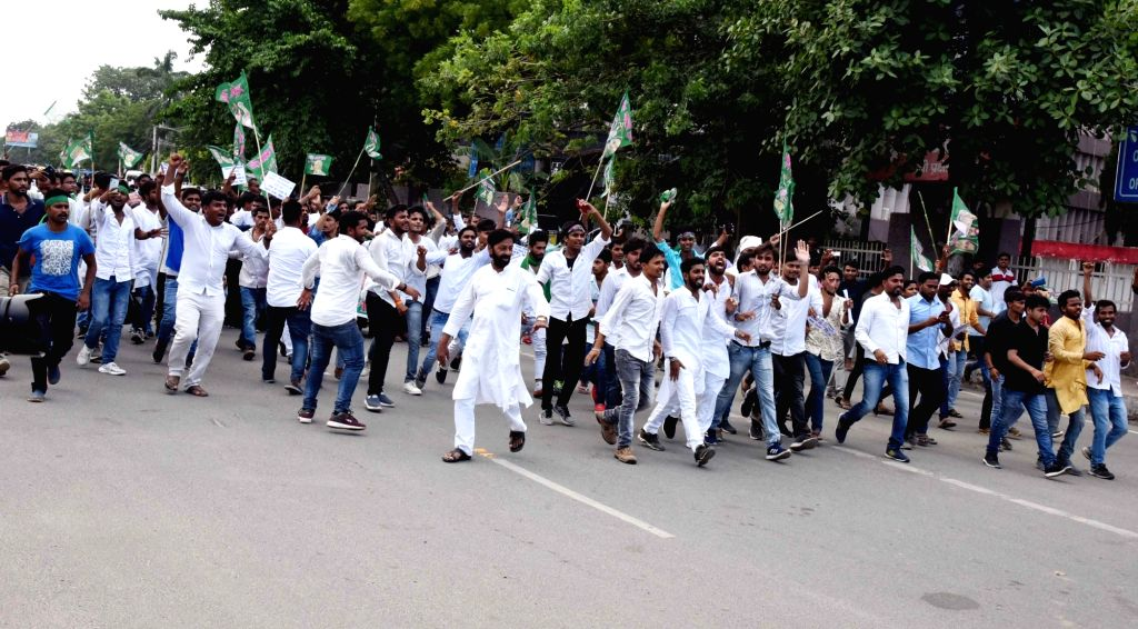RJD activists stage a demonstration to press for their various demands in Patna on July 27, 2019.