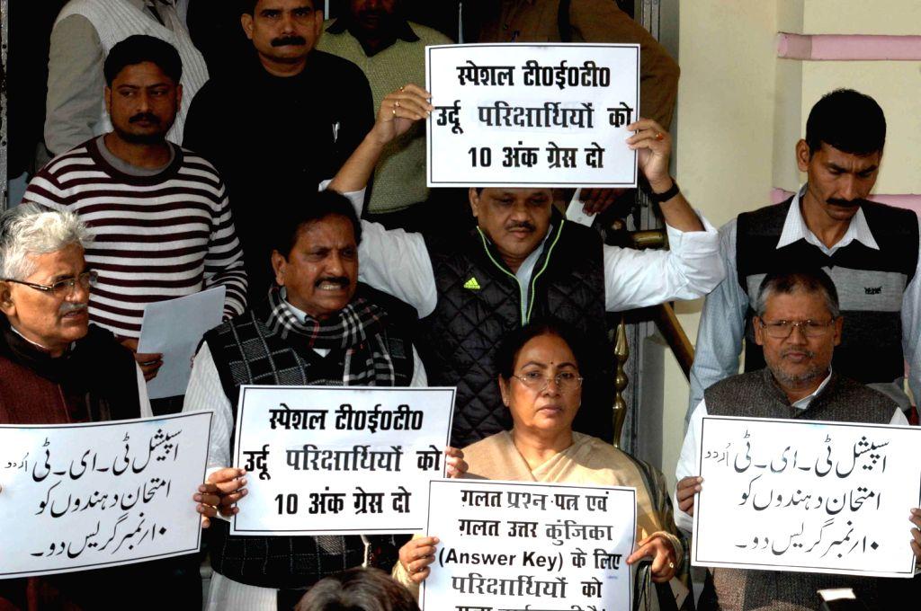 RJD and Congress legislators demonstrate in Bihar Legislative Assembly premises in Patna on Dec.13, 2013.