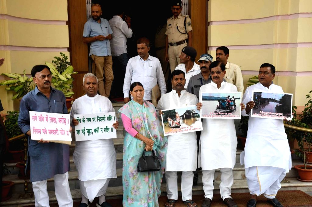 RJD and Congress legislators led by Ram Chandra Purbey, Rabri Devi and Madan Mohan Jha, stage a demonstration over the flood situation in Bihar, at the state assembly in Patna on July 17, 2019.