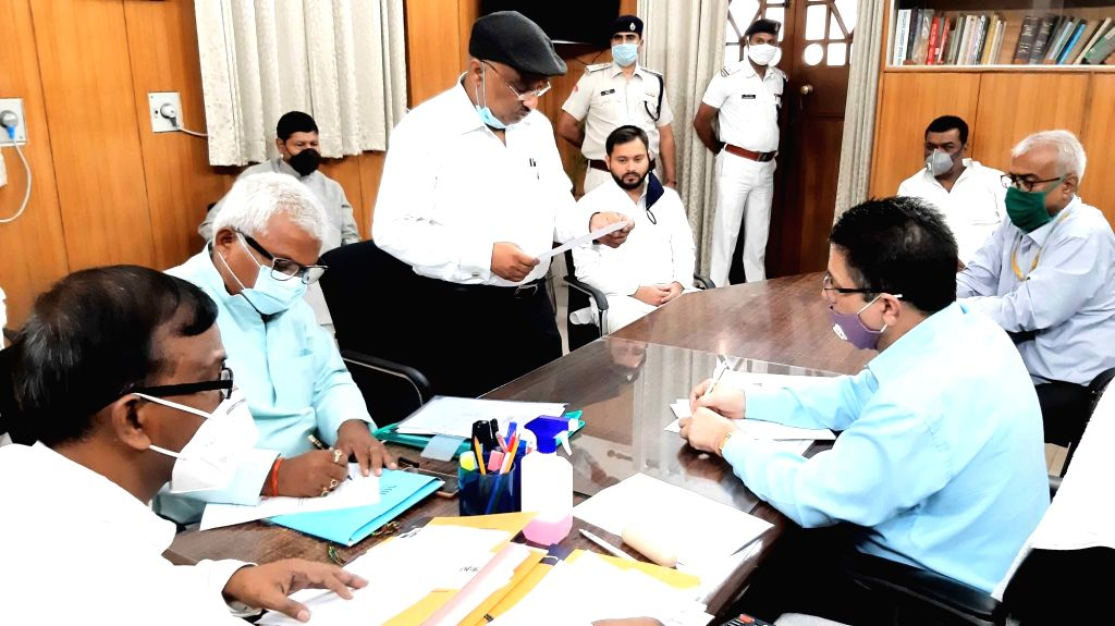 RJD candidate Sunil Kumar Singh filing his nomination papers for Bihar Legislative Council (MLC) elections, at the state assembly in Patna on June 24, 2020. - Sunil Kumar Singh