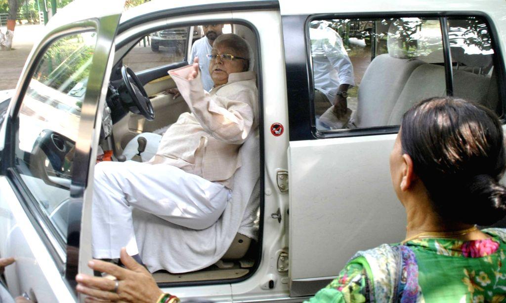 RJD chief Laloo Prasad Yadav departs for Ranchi from Patna on Aug 9, 2017. - Laloo Prasad Yadav