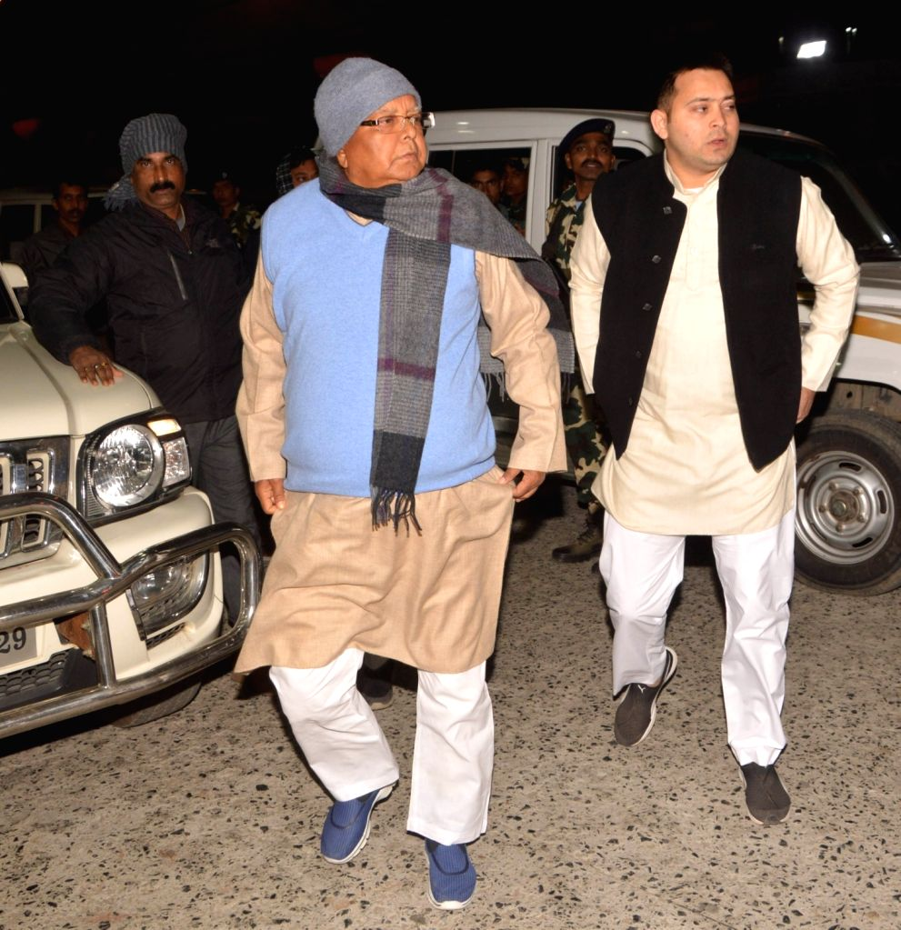 RJD chief Lalu Prasad Yadav and his son Bihar Deputy Chief Minister Tejashwi Yadav arrive to meet Union Food Minister and LJP leader Ramvilas Paswan who is undergoing treatment at a Patna ... - Tejashwi Yadav and Lalu Prasad Yadav