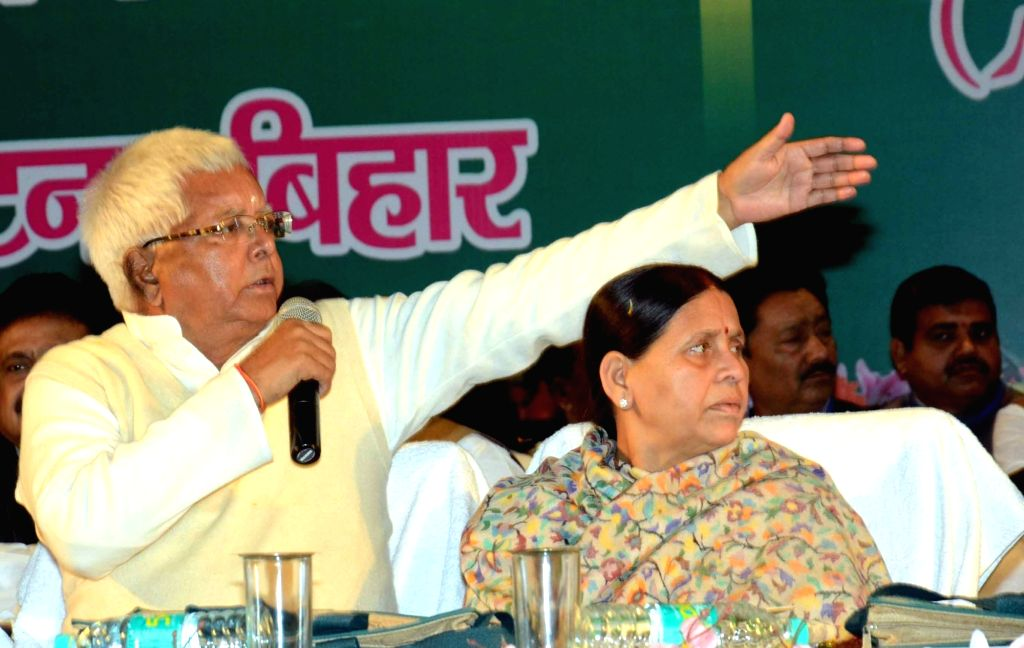 RJD chief Lalu Prasad Yadav and Rabri Devi after the former was re-elected party chief in Patna on Jan 17, 2016.