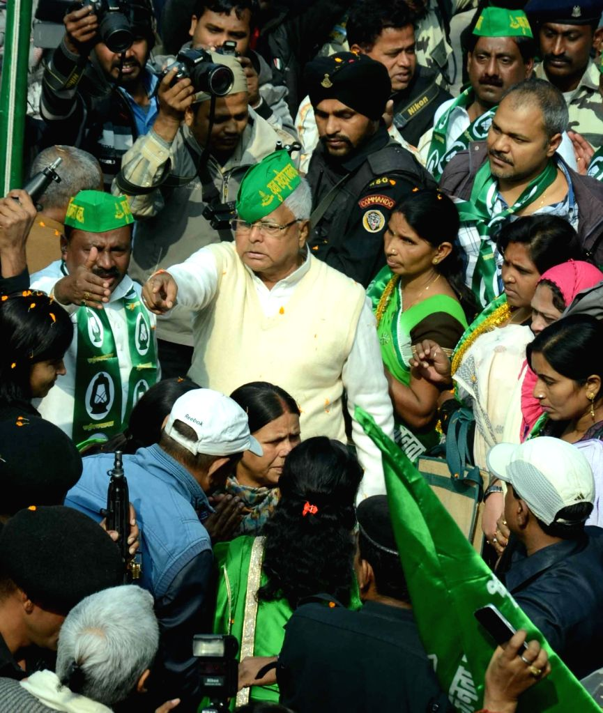 RJD chief Lalu Prasad Yadav being welcomed by party workers after he was re-elected party chief in Patna on Jan 17, 2016.