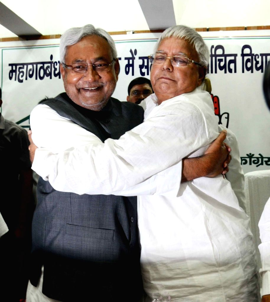 RJD chief Lalu Prasad Yadav hugs Nitish Kumar after Kumar was elected the leader of JD(U) legislative party in Patna, on Nov 14, 2015. - Lalu Prasad Yadav and Nitish Kumar