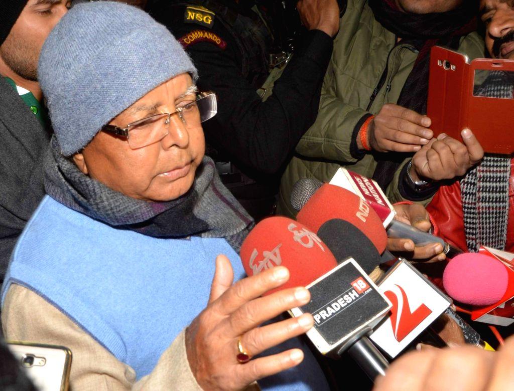 RJD chief Lalu Prasad Yadav talks to press after meeting Union Food Minister and LJP leader Ramvilas Paswan who is undergoing treatment at a Patna hospital on Jan 13, 2017. - Lalu Prasad Yadav