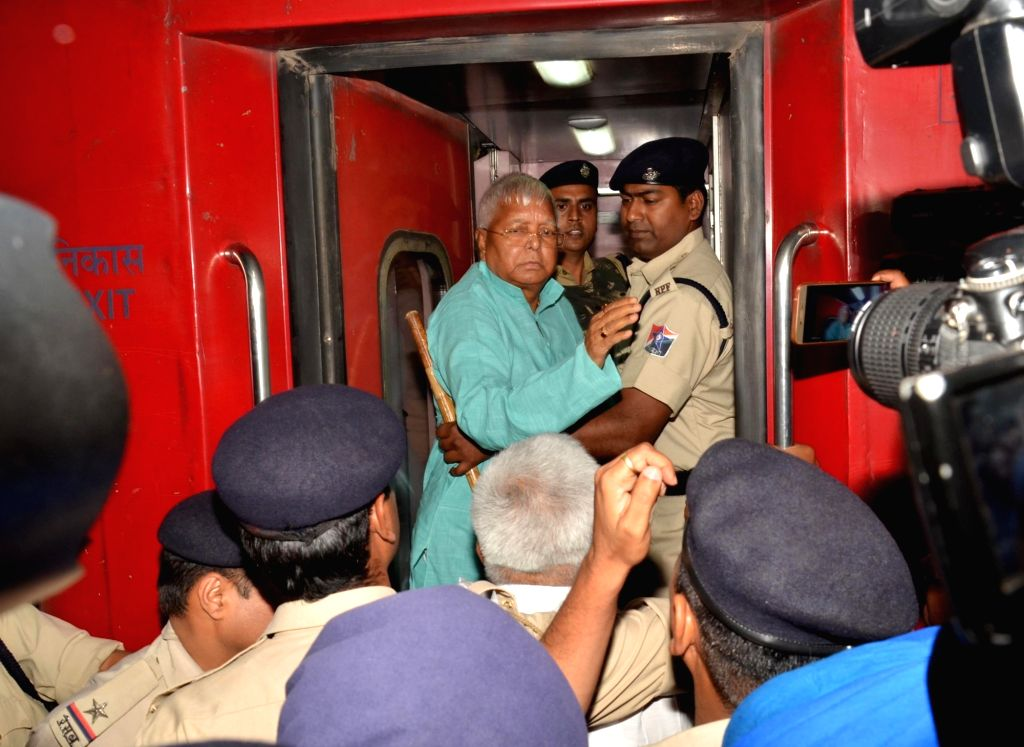 RJD chief Lalu Prasad Yadav, who is behind bars in the fodder scam cases, boards a train to New Delhi after the medical board of Rajendra Institute of Medical Science (RIMS) referred him to ... - Lalu Prasad Yadav