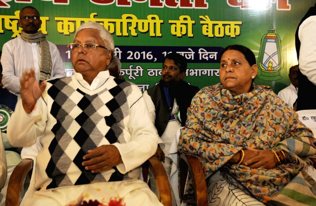 RJD chief Lalu Prasad Yadav with his wife Rabri Devi during party programme in Patna, on Jan 16, 2016. - Lalu Prasad Yadav