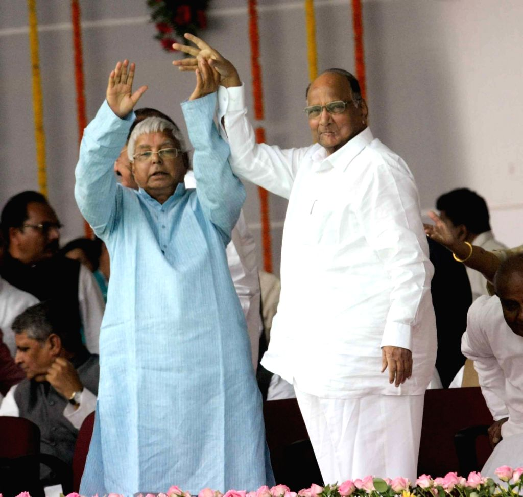 RJD chief Lalu Prasad Yadav with NCP Chief Sharad Pawar  during the swearing-in ceremony of the new JD-U-RJD-Congress coalition government in Patna, on Nov 20, 2015. - Lalu Prasad Yadav