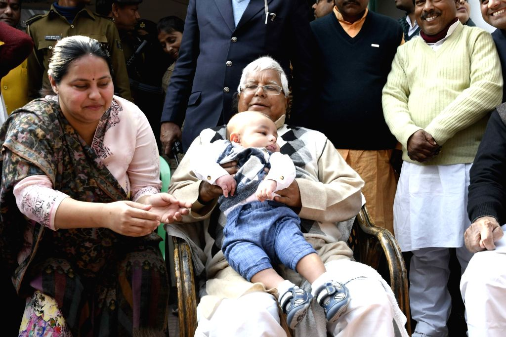 RJD chief Lalu Yadav plays with his grandson in Patna, on Jan 14, 2017. - Lalu Yadav
