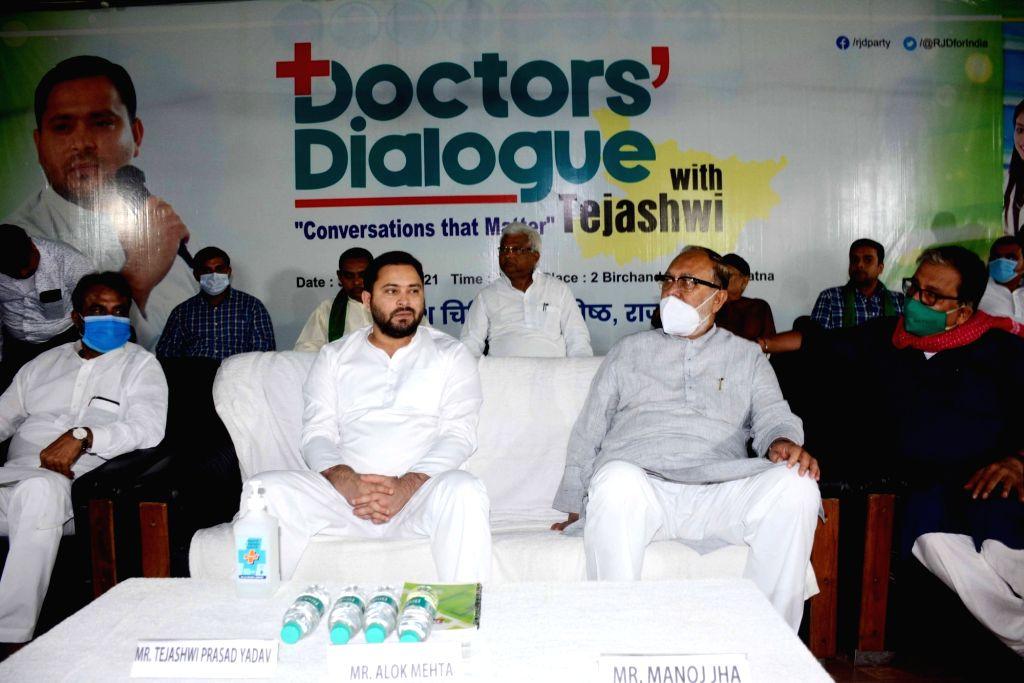 RJD er Tejaswi Yadav speak during the Doctors Dialogue programme organised by RJD'S  Medical cell in Patna on Sunday October 03,2021. - Tejaswi Yadav