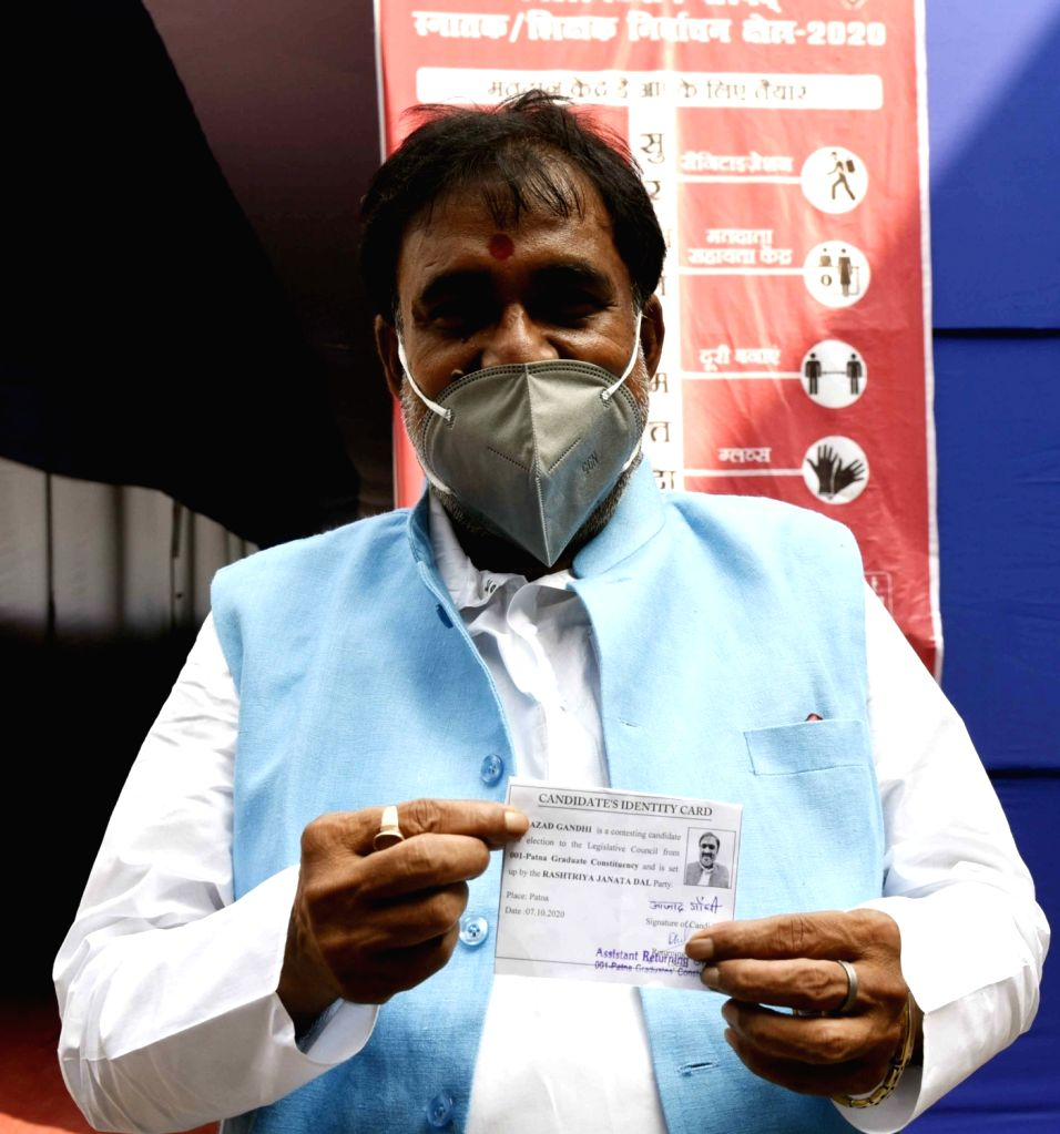 RJD graduate constituency seat candidate Azad Gandhi shows his voter ID card after casting his vote for Bihar Legislative Council elections, in Patna on Oct 22, 2020. - Azad Gandhi