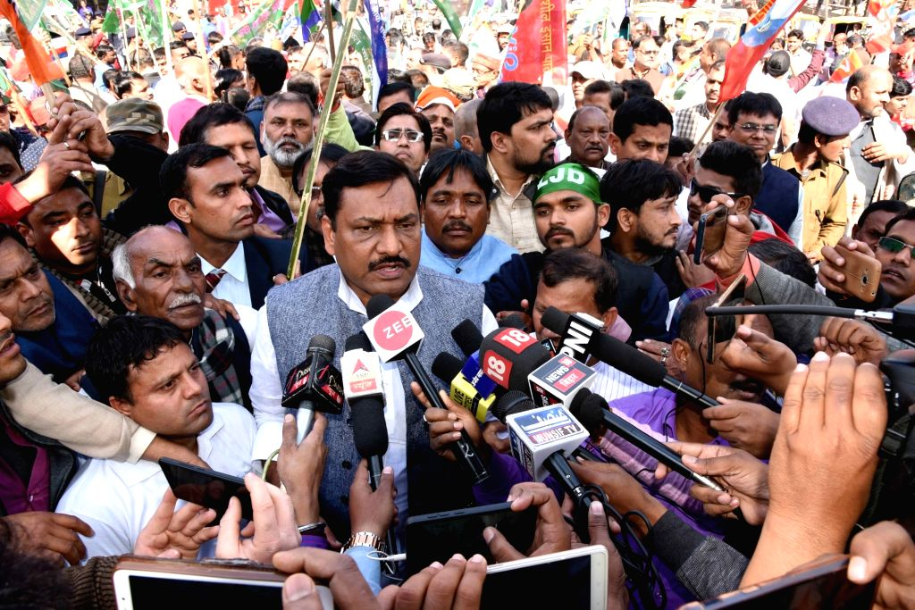 RJD leader Akhilkesh Singh talks to media persons during a statewide strike called to protest against police lathicharge on protesting Rashriya Lok Samata Party (RLSP) leaders and workers, in ... - Upendra Kushwaha and Akhilkesh Singh