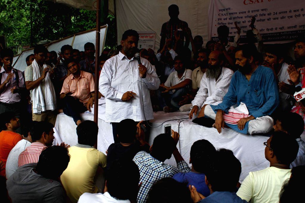 RJD leader Pappu Yadav and Aam Aadmi Party (AAP) leader Yogendra Yadav join civil service aspirants demonstrating against Civil Services Aptitude Test (CSAT) at Jantar Mantar in New Delhi on Aug 12, .