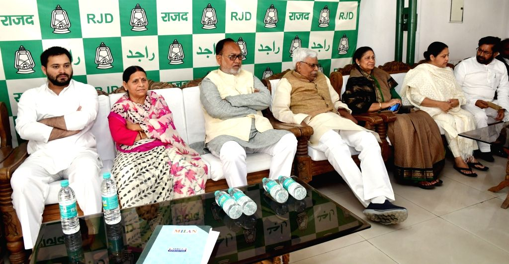 RJD leader Rabri Devi and Tejashwi Yadav during a party meeting in Patna on March 9, 2019. - Tejashwi Yadav