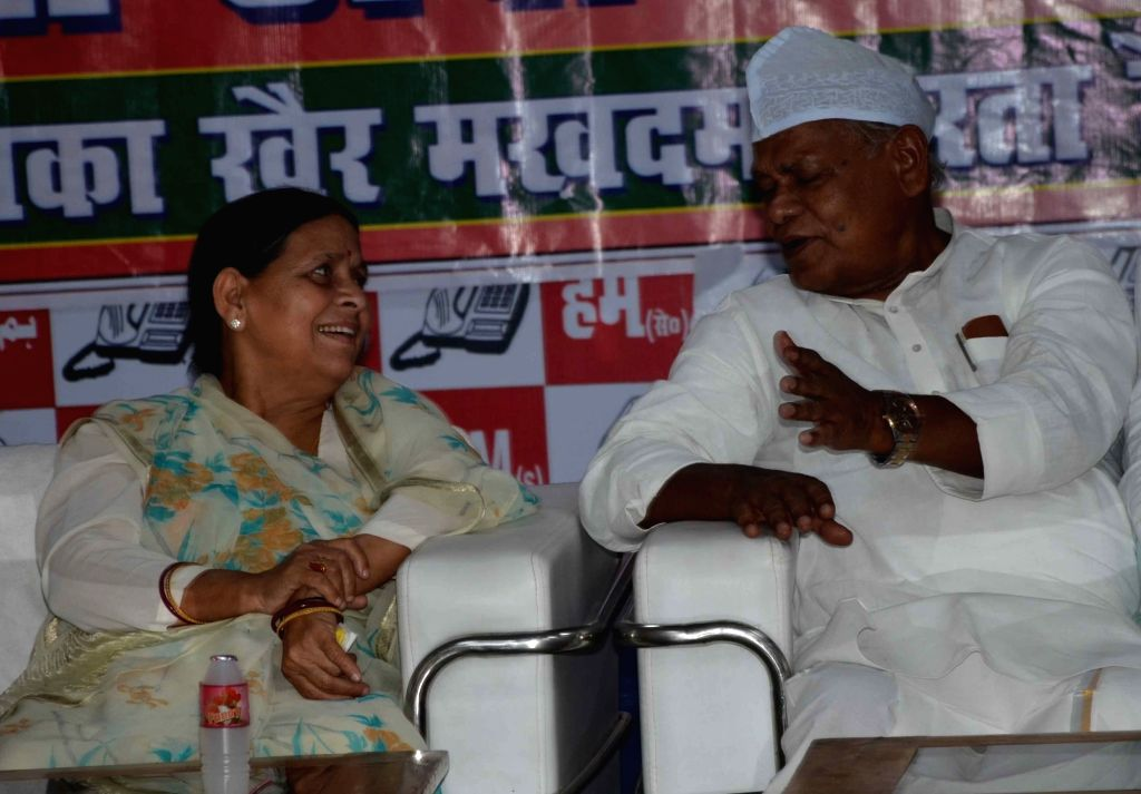 RJD leader Rabri Devi in a conversation with Jitan Ram Manjhi during an iftar party in Patna, on June 3, 2019.