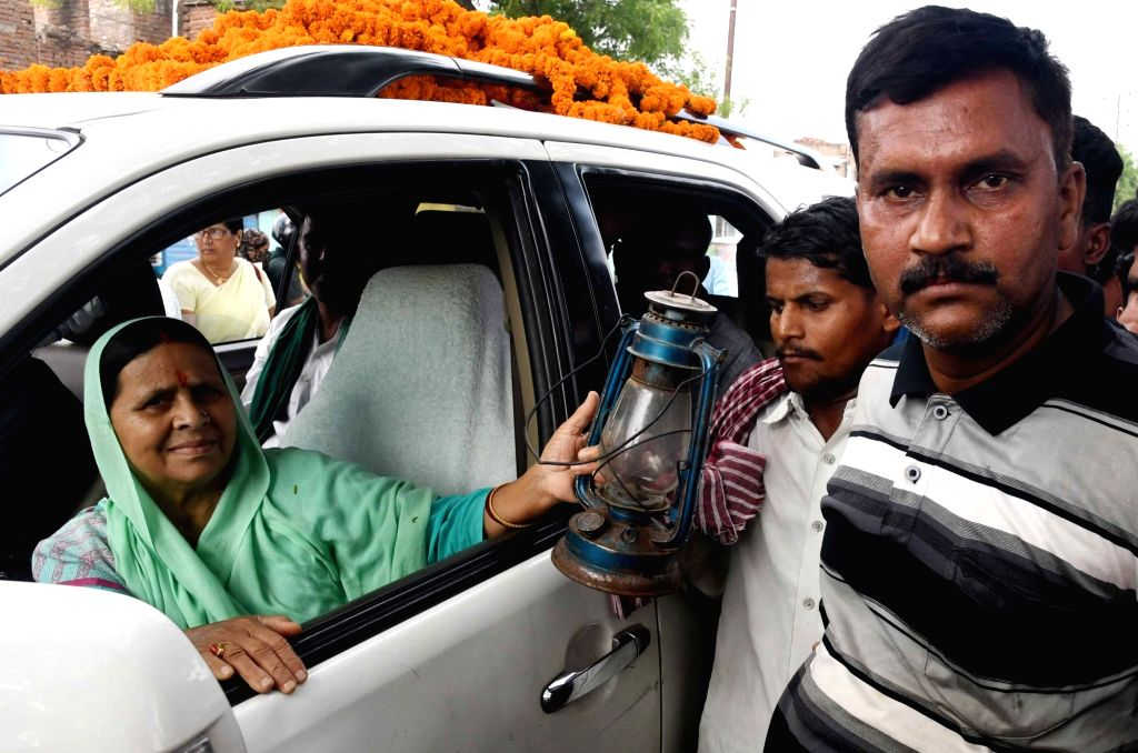 RJD leader Rabri Devi reaches out to the supporters as she campaigns for her daughter and the party's Lok Sabha candidate from Patliputra, Misa Bharti ahead of the 2019 Lok Sabha elections, in ...