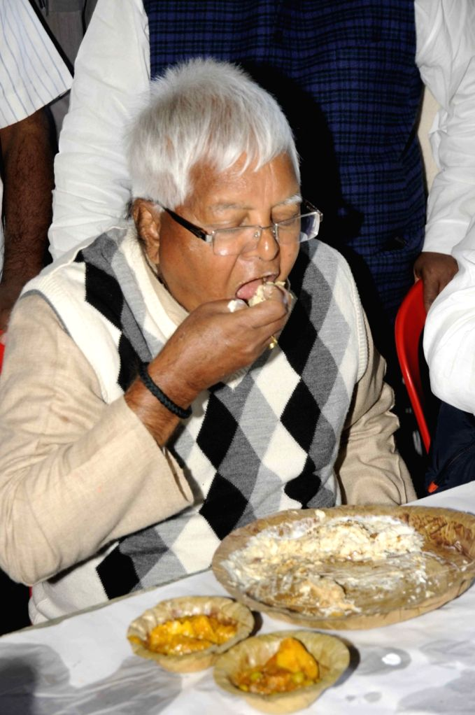 RJD leader Rabri Devi serves dahi-chura - rice flakes and curd to her guests on Makar Sankranti in Patna, on Jan 14, 2017.
