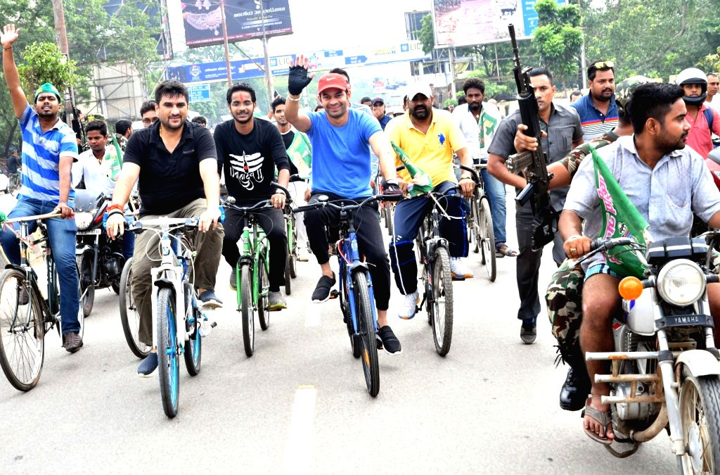 RJD leader Tej Pratap Yadav along with party workers participates in RJD's cycle rally, in Patna on July 26, 2018. - Tej Pratap Yadav