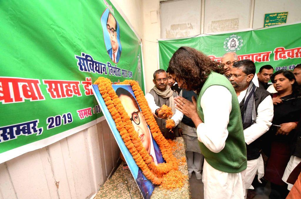 RJD leader Tej Pratap Yadav pays tributes to Dr B.R. Ambedkar on his 64th death anniversary commemorated as Mahaparinirvan Diwas, at the party office in Patna on Dec 6, 2019. - Tej Pratap Yadav