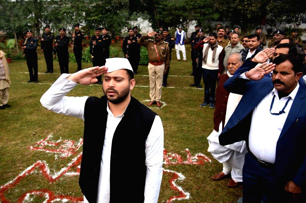 RJD leader Tejashvi Yadav salutes the tricolor at the flag hoisting ceremony during the 71st Republic Day celebrations, in Patna on Jan 26, 2020. - Tejashvi Yadav